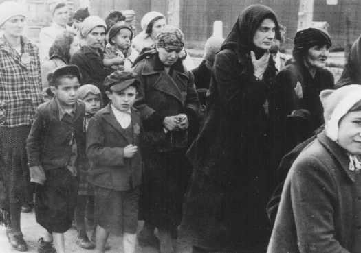 Jewish women and children being sent to a concentration camp . Photo credit USHMM