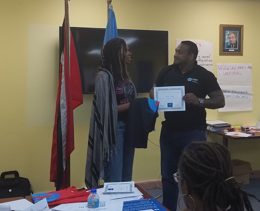 UNIC colleague Ruben, receives his certificate as a UN Cares trainer. photo credit: UNIC/W Ramnarine
