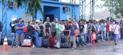 Venezuelans arrive in Pacaraima, border city with Venezuela, and wait at the Federal Police, the entity responsible for receiving Venezuelans seeking asylum or special stay permits in Brazil, 16 February 2018.