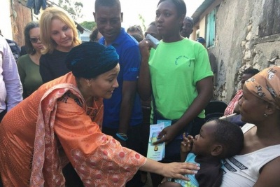 eputy Secretary-General Amina Mohammed (foreground left) and UN Special Envoy for Haiti Josette Sheeran (rear left) with Haitian families affected by cholera.