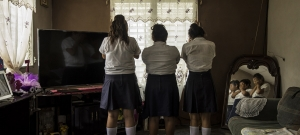 Pictured here are three girls in Progreso, Yoro, Honduras, ages 13 to 14, who are friends and victims of harassment at their school, for the purpose of sex trafficking. The person behind it is a 15 year-old student that works with a network that coops young girls against their will to work as prostitutes.
