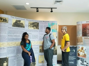 Model UN delegate trainees take some time to visit the exhibit on the holocaust at the COSTAATT atrium