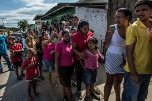 Shoppers wait in line for five hours to buy a ration of bread from a small bakery in Cumaná, Venezuela
