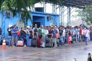 Venezuelans wait outside the Federal Police office in the Brazilian border city of Pacaraima. The office is responsible for receiving Venezuelans seeking asylum or special permits to stay in Brazil.