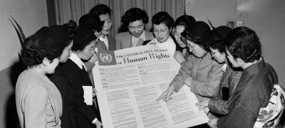 A group of Japanese women look at the Universal Declaration of Human Rights during a visit to the UN's interim headquarters in Lake Success in February 1950