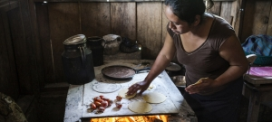 20 July 2017, San Lorenzo, Chiapas, Mexico - Emilia Felipe Jose making tortillas in her home in the village of San Lorenzo. The villlage is populated by Guatemalans who fled their country some years ago
