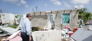Secretary-General António Guterres walks through a neighbourhood destroyed by back-to-back hurricanes in Codrington town, Antigua and Barbuda. He visited the country to survey the devastation and offer support from the Organization.