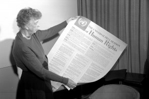 Eleanor Roosevelt of the United States holding a Declaration of Human Rights poster in English. (November 1949).