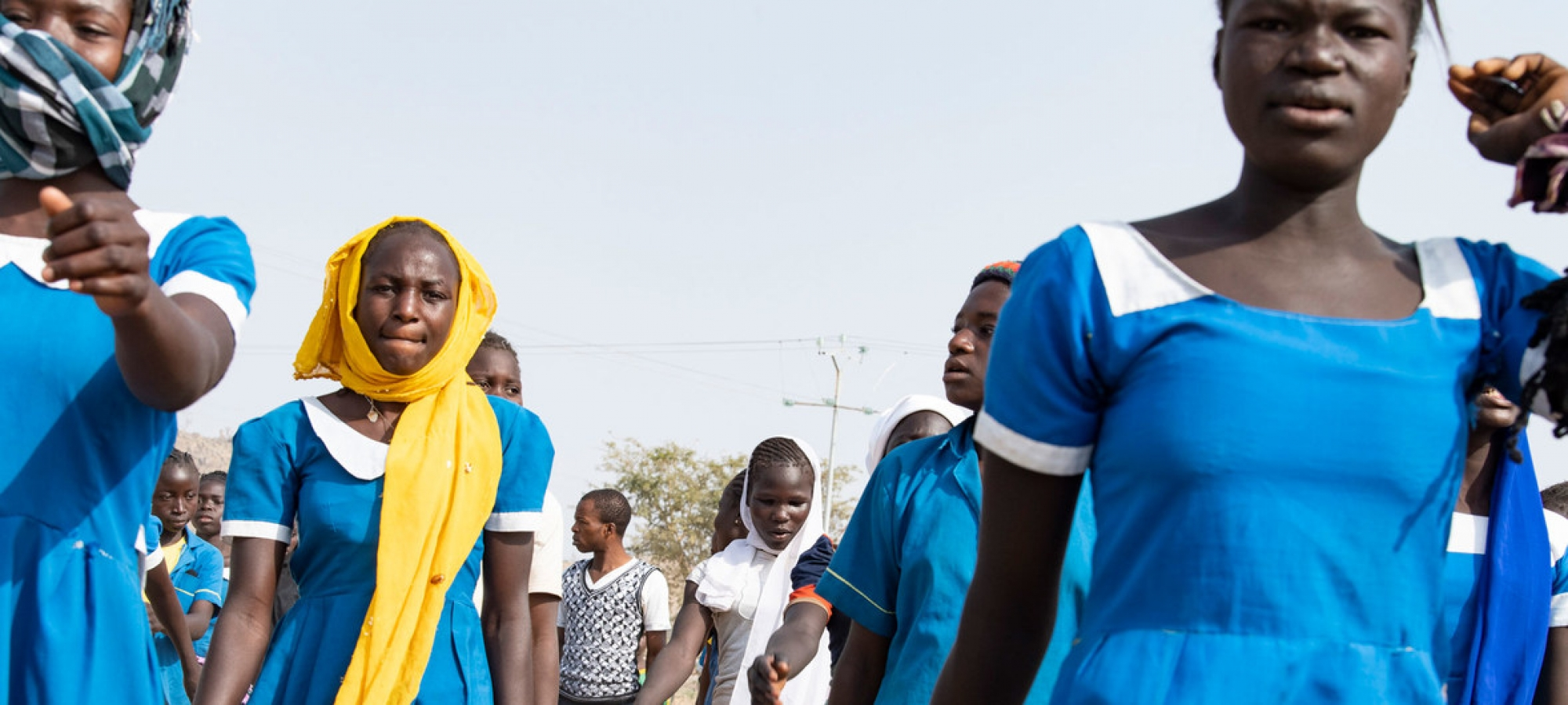 Young women leave school in the town of Bol in Chad after classes.