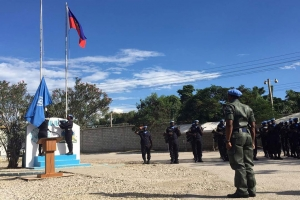 The UN flag is raised at the opening ceremony for the new United Nations Mission for Justice Support in Haiti (MINUJUSTH).