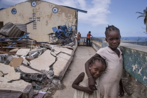 In Jérémie, Haiti, children play at the Église Chrétienne Nan Lindy. Hundreds of people have sought temporary shelter at the church after countless homes were destroyed by Hurricane Matthew.