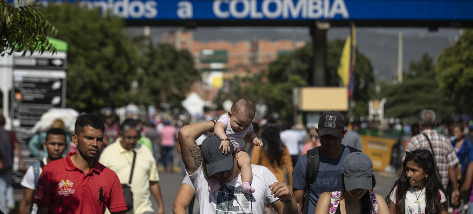 file photo: Venezuelan refugees and migrants cross the Simon Bolivar Bridge into Colombia