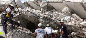 Rescuers search through a United Nations building destroyed by the earthquake which struck Haiti on 12 January, 2010.