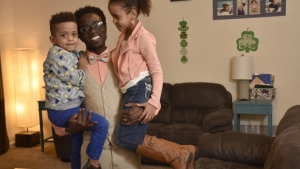 Bertine Bahige, 38, and his two children in their home in Gillette, Wyoming getting ready for the school day