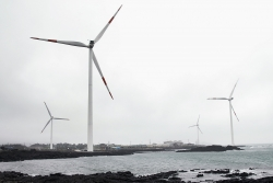 A floating windmill complex generates electricity on Jeju Island, Republic of Korea.