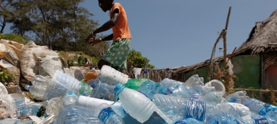Local people from Watamu, Kenya, work with Local Ocean Conservation to pick up plastic on the beach.